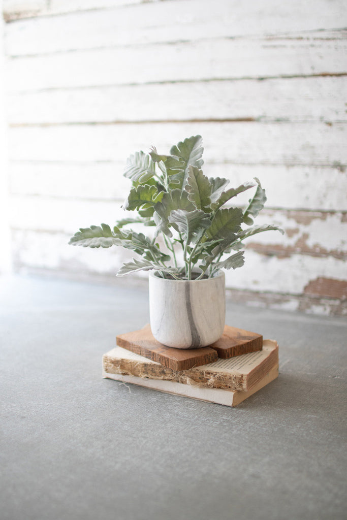 Artificial Plant in a Faux Marble Pot