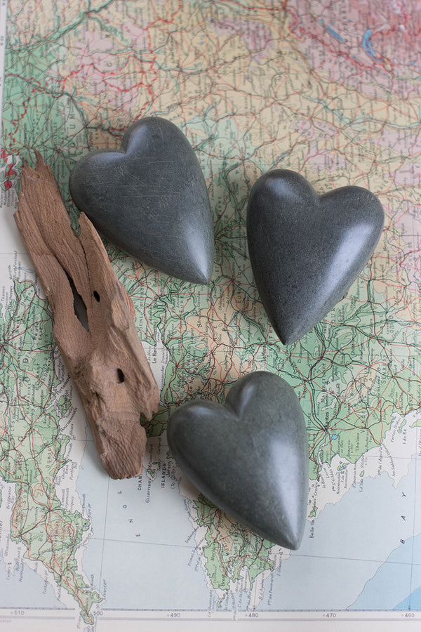 SET OF SIX HAND CARVED STONE HEART-DARK GREY