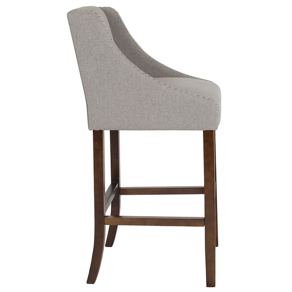 "Carmel Series 30"" High Transitional Walnut Barstool with Accent Nail Trim in Light Gray Fabric"