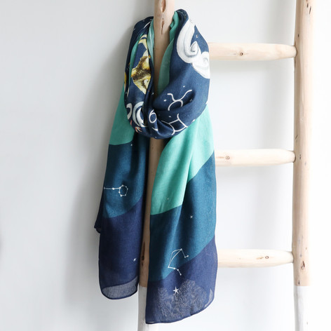 navy and teal zodiac scarf hanging on ladder
