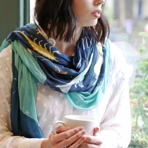 navy and teal scarf worn on model