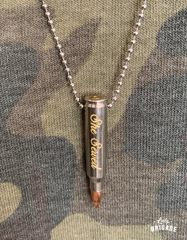 "A necklace engraved with ""She Served"" on it."