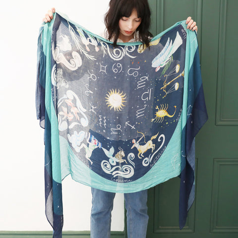 navy and teal scarf opened showing zodiac designs