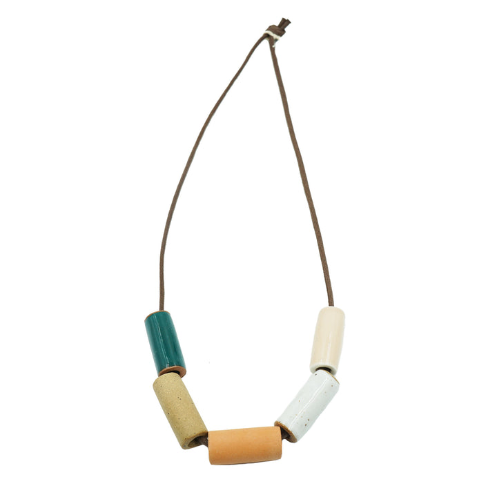Teal/ Natural Ceramic Bead Necklace by The Pursuits of Happiness