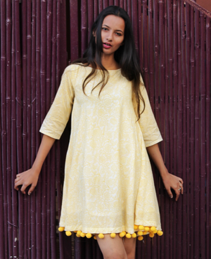 Yellow Pastel Floral Block Printed Swing Dress with Handmade Pompoms by Mogra Designs