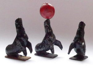 Charbens performing circus seals, three