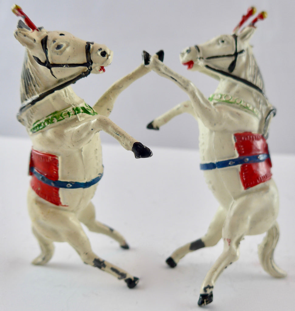 Timpo rearing Liberty horses, two
