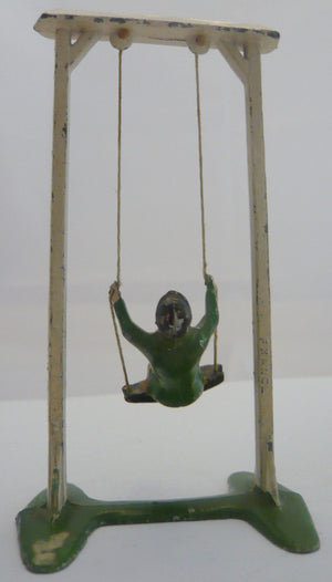 French boy on swing, green
