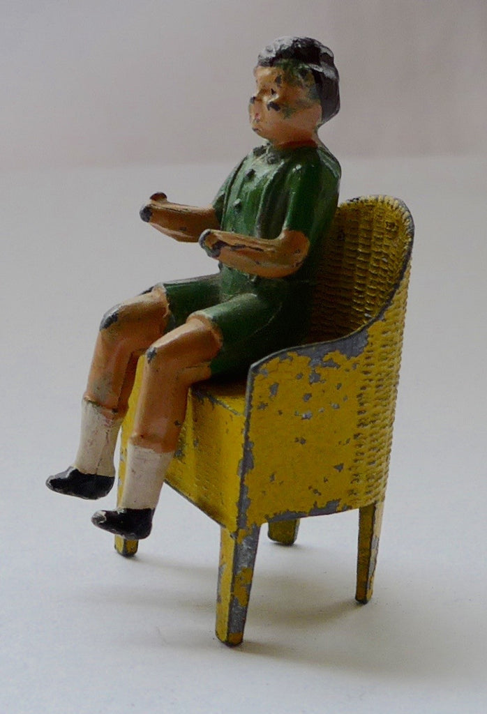 Crescent boy on basketweave chair from garden party set
