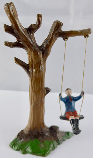 French boy on tree swing