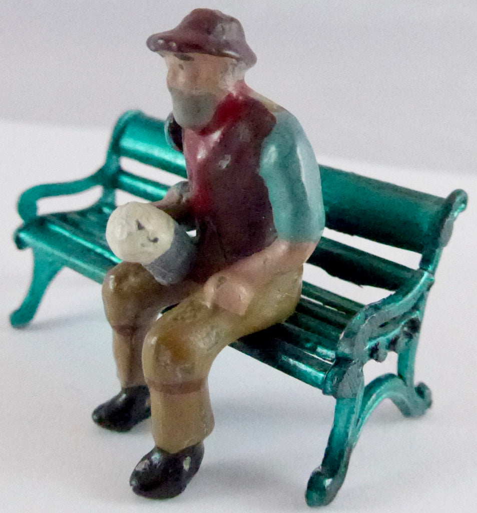 Pixyland Kew village quaffer, seated on Johillco bench