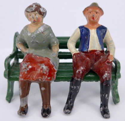 French couple sitting on bench