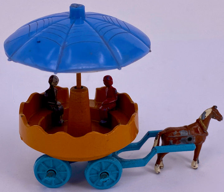 interesting horse drawn rotating carousel, possibly Sacul
