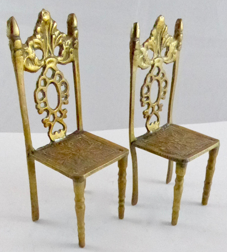 two large scale brass chairs