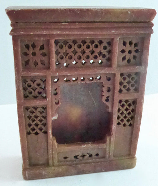 carved stone fireplace, brown