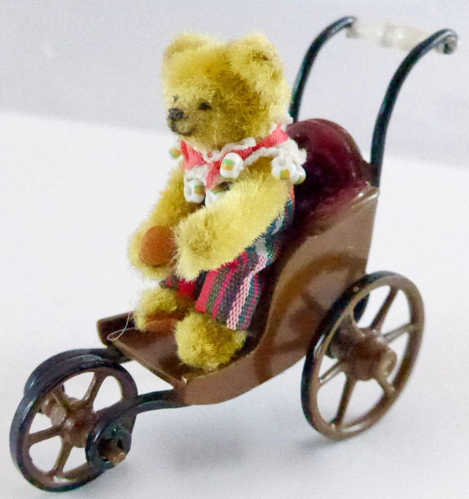 three wheel baby carriage with teddy