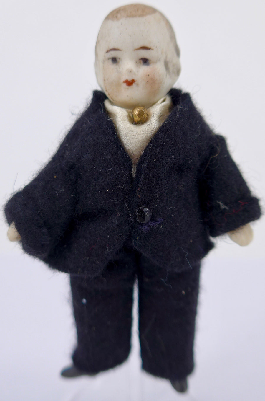 young male bisque dollhouse doll, black suit