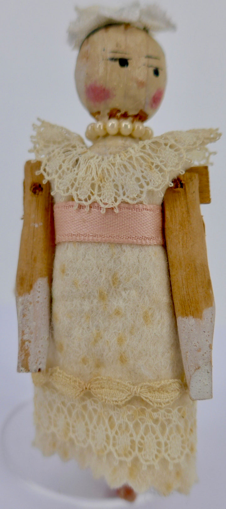 vintage jointed wooden peg doll, cream and pearls