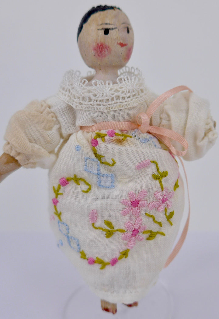 vintage jointed wooden peg doll, embroidered