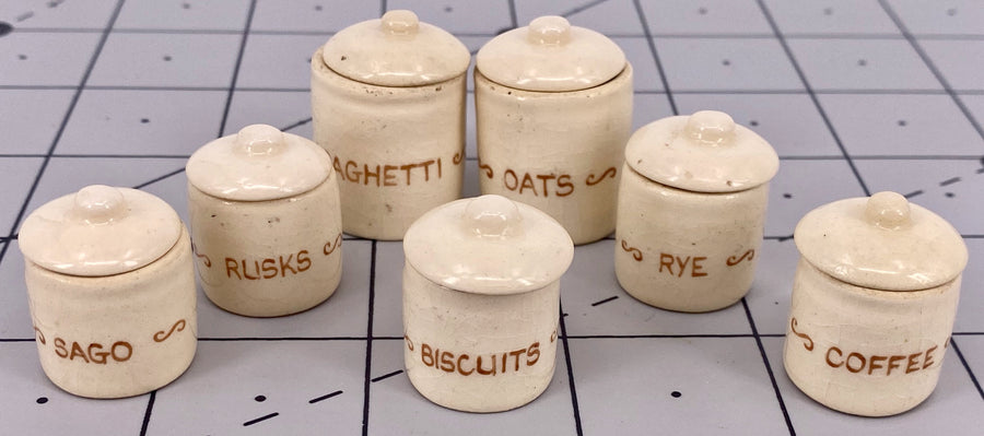 set of seven dollhouse food storage jars