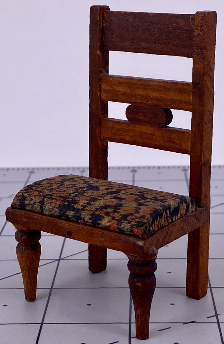 an unusual wooden chair for doll house