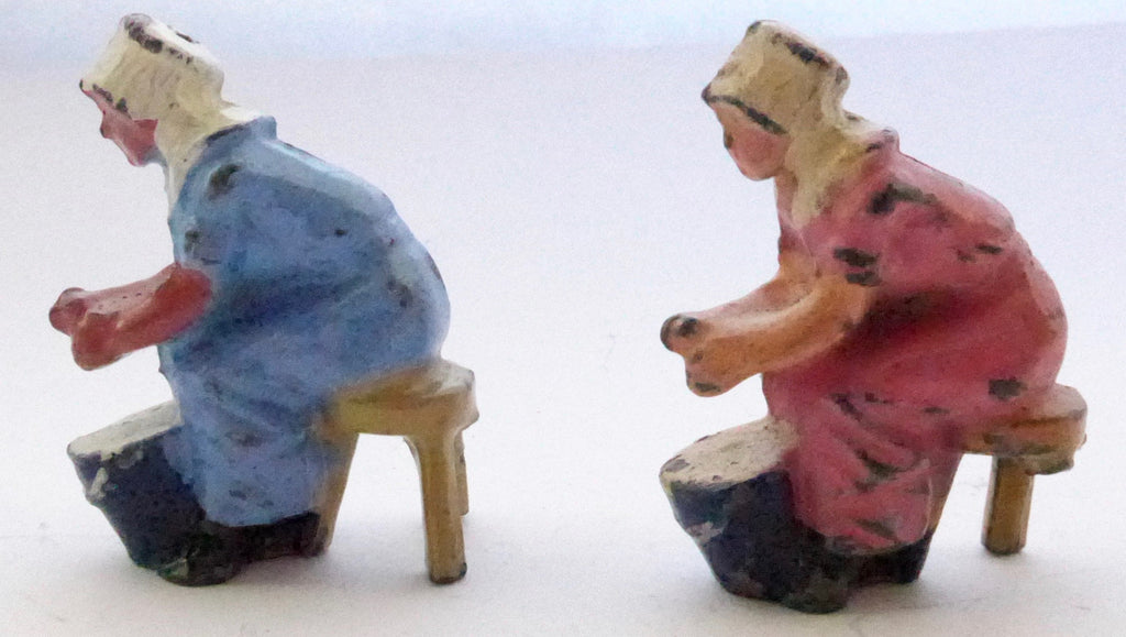 two Johillco seated milkmaids