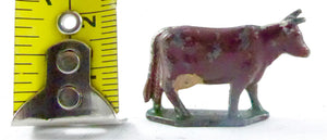 small scale brown cow