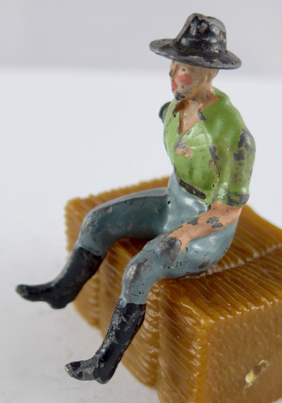 Britains farm hand seated, green