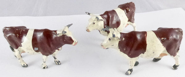 three Britains cows standing