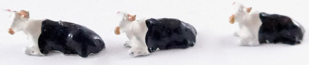 Britains Lilliput series three calves lying down, black