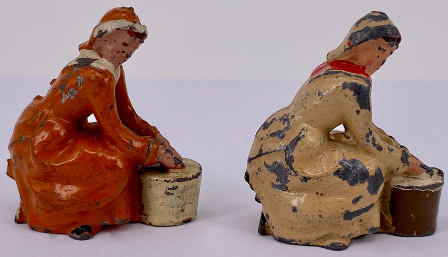 Britains seated milkmaids, pair, cream and orange