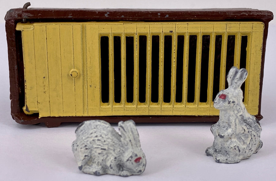 F G Taylor rabbit hutch and two white rabbits