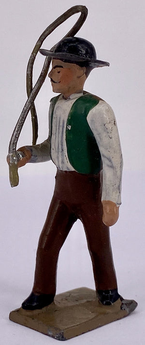 CBG Mignot farm worker with whip