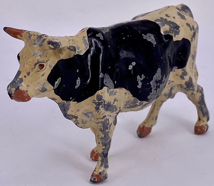 Britains cow, off-white with black markings