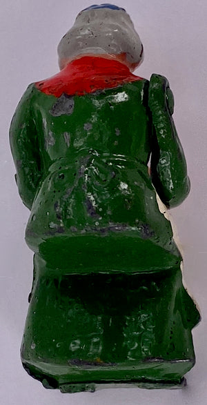 Britains aged village woman sitting, green
