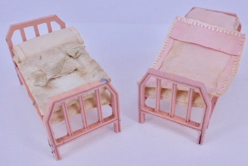Tootsie Toy pink bed frames, pair