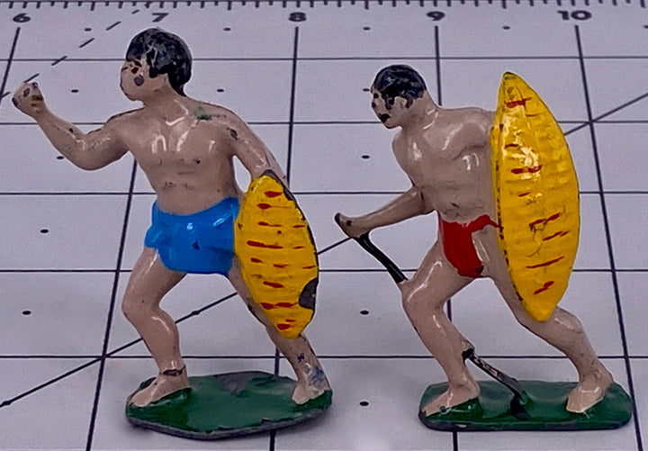 Two Timpo? figures with shields