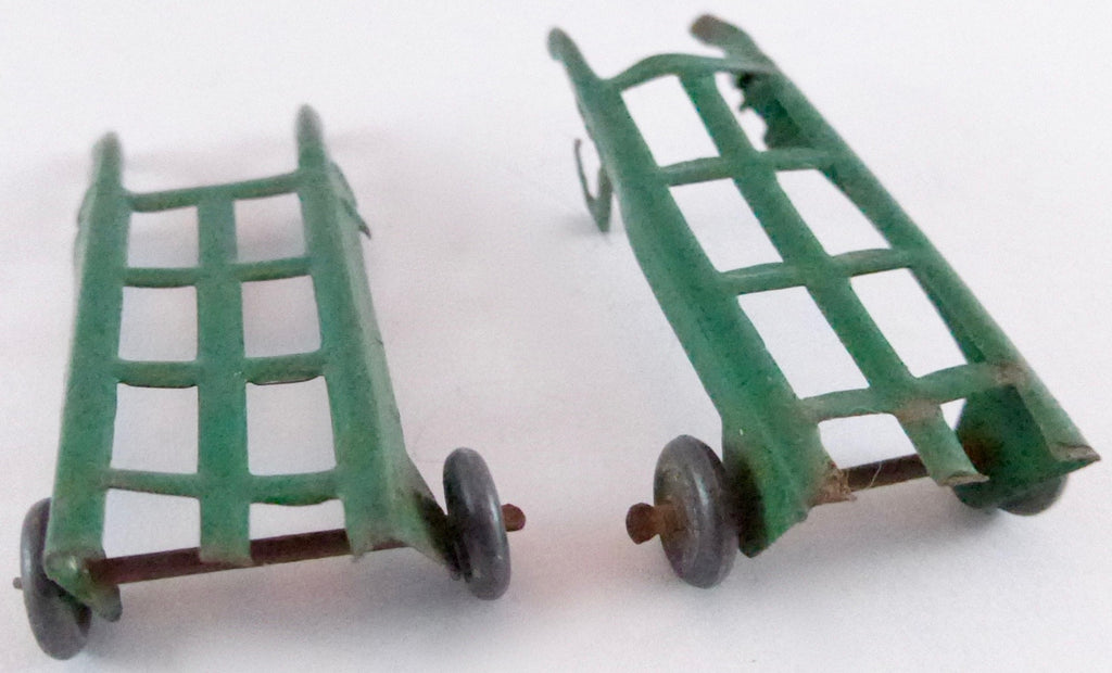 two green luggage trolleys