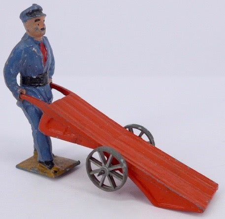 French railway porter with flat  luggage trolley