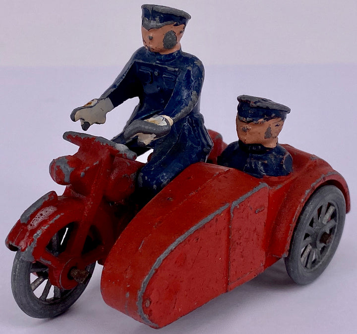 Red motorcycle and sidecar, possibly Morestone