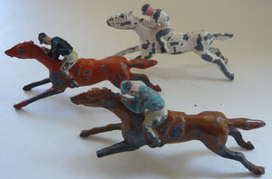 three racehorses in full gallop