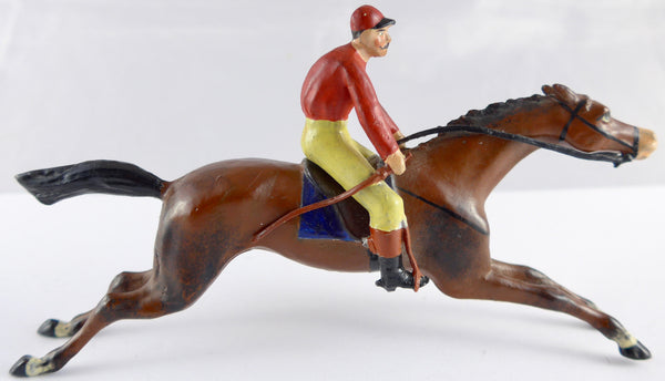 Heyde racehorse and rider in full gallop, red