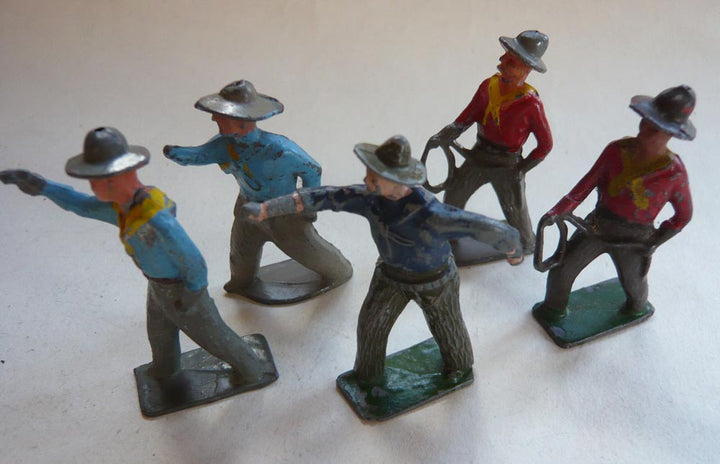 five standing Crescent  cowboys