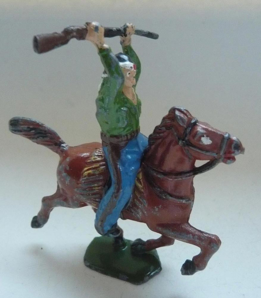 Timpo mounted cowboy holding rifle over bandaged head