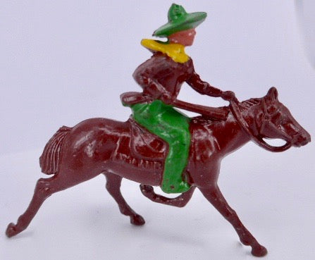 Johillco cowboy on galloping brown horse