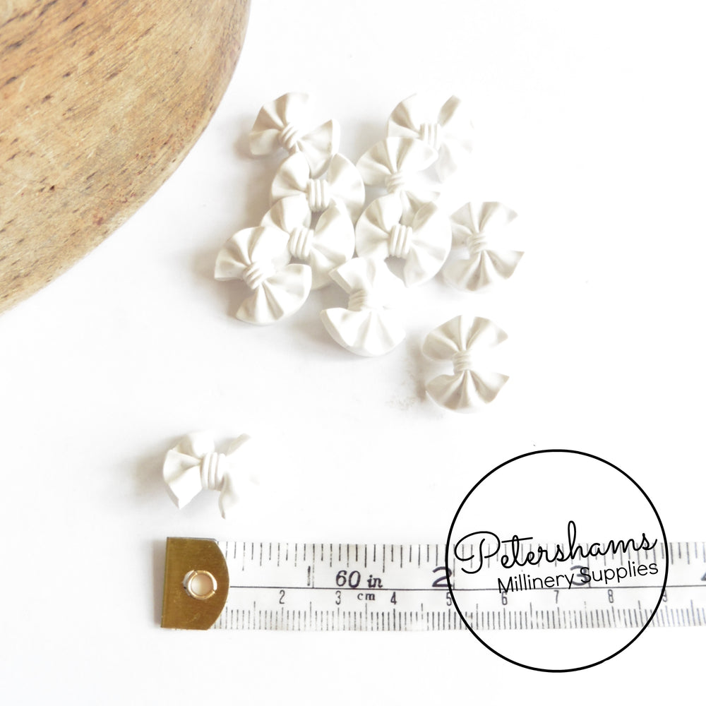 Vintage 1960s White Plastic Bow Buttons