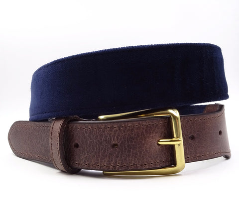 Blue velvet belt with a solid brass buckle. Made in USA.