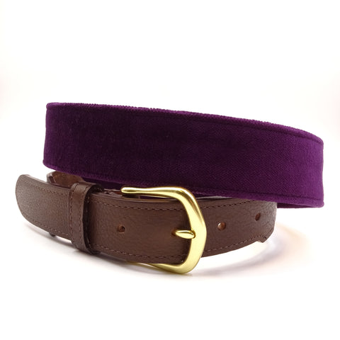 Aubergine velvet belt with a solid brass buckle. Made in USA.