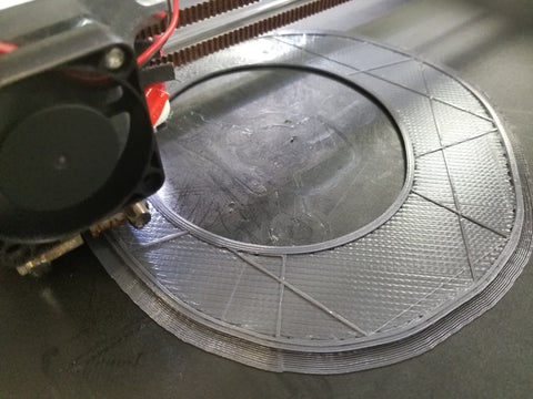 An M3D Promega printing a large object in PLA
