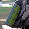 green ax410 speaker carabiner attached to backpack